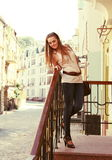 Young Woman Upstairs Posing Outdoors Royalty Free Stock Photos