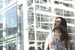 Young Woman in Urban Setting. Attractive Young Woman in the city royalty free stock photography