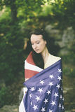 Young woman with usa flag royalty free stock photography