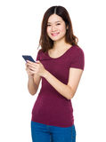 Young woman use of the cellphone Royalty Free Stock Photo