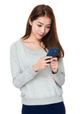 Young woman use of cellphone Stock Image