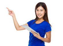 Young woman use of the digital tablet and finger pointing up Royalty Free Stock Images