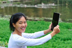 Young woman use ipad Royalty Free Stock Photo