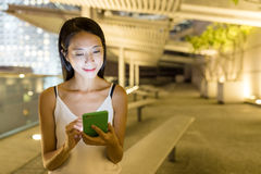 Young woman use of mobile phone in the city. Asian young woman Stock Photography