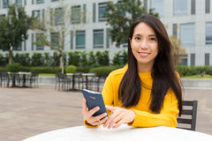 Young Woman use of the mobile phone Royalty Free Stock Images