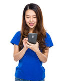 Young woman use mobile phone Stock Photography