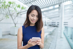 Young woman use of mobile phone Royalty Free Stock Images
