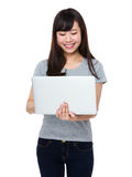Young Woman use of the notebook computer Stock Photography
