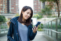 Young woman use the phone Stock Photography
