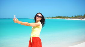 Young woman use phone taking selfie on the beacj. Tourist using mobile smartphone. stock footage