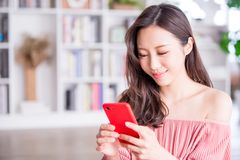 Woman use smart phone and feel happy at home. Young woman use smart phone and feel happy at home royalty free stock photo