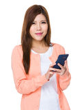 Young woman use of the smartphone Stock Photography