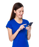 Young woman use of smartphone Royalty Free Stock Photo