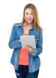Young woman use of the table pc Royalty Free Stock Image