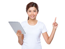 Young woman use of tablet and finger point up Stock Images