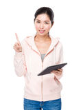 Young Woman use of the tablet and finger point up Stock Image