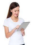 Young woman use of tablet Royalty Free Stock Photos