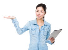 Young woman use of tablet and open hand palm Stock Photography