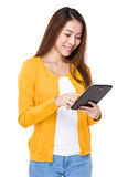 Young woman use of the tablet pc Stock Image
