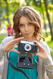Young woman uses film photocamera. Royalty Free Stock Photos