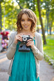 Young woman uses film photocamera. Royalty Free Stock Photo