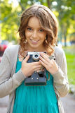 Young woman uses film photocamera. Stock Photos