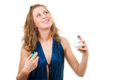 Young woman uses perfume Royalty Free Stock Image