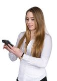 Young woman uses a smart phone. Cut out image of a young woman who is using a smart phone while looking to the smart phone Royalty Free Stock Images