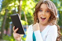 Young woman uses tablet pc. Royalty Free Stock Photo