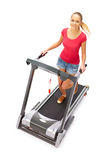 Young woman uses treadmill. royalty free stock photo