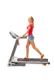 Young woman uses treadmill. Stock Photos