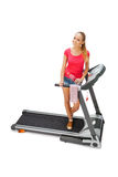 Young woman uses treadmill. Stock Photo