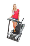 Young woman uses treadmill. Royalty Free Stock Images