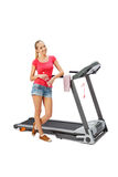 Young woman uses treadmill. Stock Photography