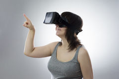 Young woman uses a virtual reality glasses Stock Images
