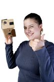 Young woman uses virtual reality (VR cardboard)  on white background Royalty Free Stock Images