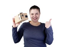 Young woman uses virtual reality (VR cardboard)  on white background Royalty Free Stock Photography