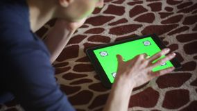 Young woman using Apple Ipad at home. Young woman playing with Apple Ipad at home on giraffe bedcover green screen ready hands only stock footage