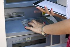 Young woman using ATM Royalty Free Stock Images