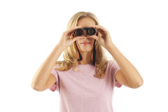 Young woman using binoculars Royalty Free Stock Images