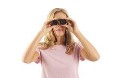 Young woman using binoculars. Young woman looking through binoculars Royalty Free Stock Images