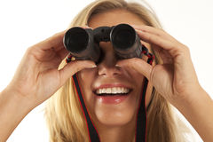 Young woman using binoculars Stock Photography