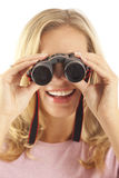 Young woman using binoculars Stock Image
