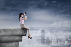 Free Young Woman Using Binoculars On Rooftop Royalty Free Stock Image - 41594956