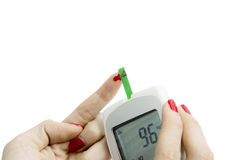 Young woman using a blood glucose meter Royalty Free Stock Images