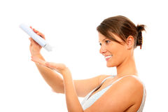 Young woman using body lotion Royalty Free Stock Photo