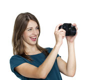 Young woman using a camera to take photo Stock Images