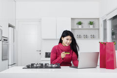 Young woman using card credit and laptop Royalty Free Stock Image