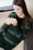 Young woman using cell phone Royalty Free Stock Photography