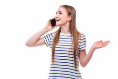 Young Woman Using a Cell Phone. Isolated on White Royalty Free Stock Photography